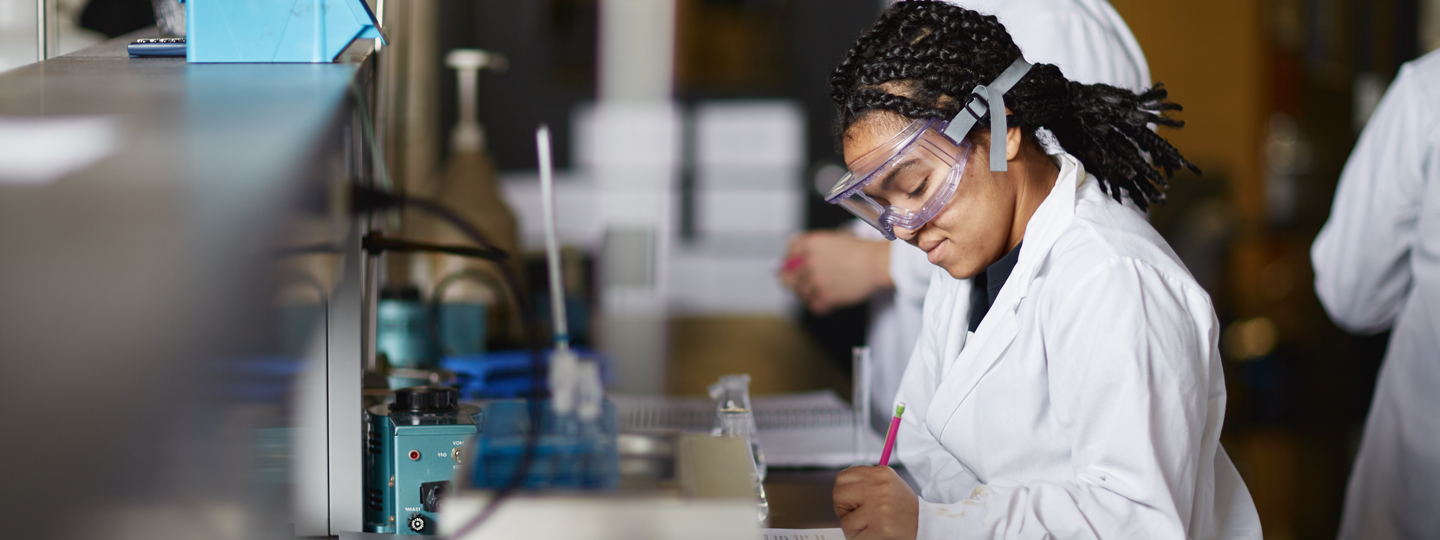 female chemistry student working in lab